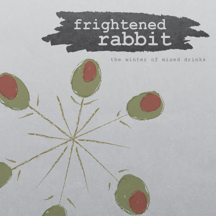 "An illustrated CD cover displaying a series of toothpicks with olives on them, arranged in the shape of a snowflake. The title ""The Winter of Mixed Drinks"" is written on the muted grey background."